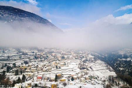 Valtellina (IT), Sondrio, Frazione Sant'Anna, Mossini, Winter aerial view Archivio Fotografico
