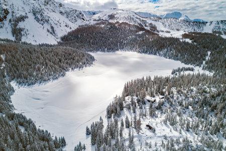 Palù Lake, Valmalenco (IT), Winter aerial view with fresh snow Archivio Fotografico