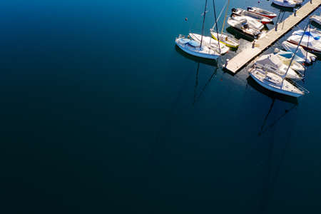 Moored sailboats and pleasure boats, aerial view