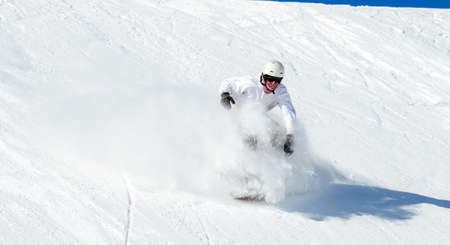 Snowboarder in action on the track with fresh snow Archivio Fotografico