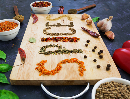 Different spices on dark background Stock Photo