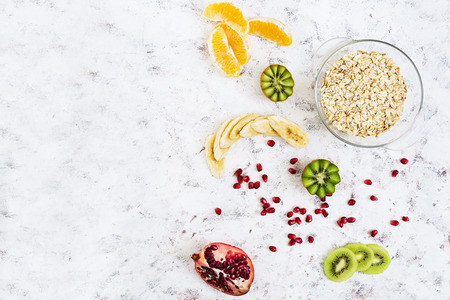 Healthy breakfast. Oatmeal with fruit on white background. Top view