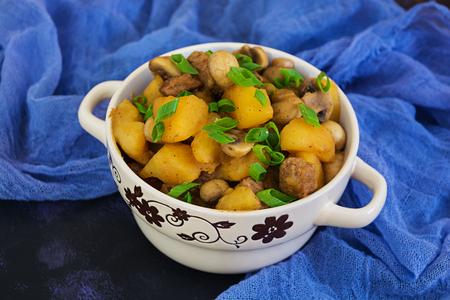 Stewed potatoes on dark background
