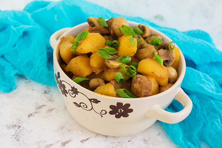 Stewed potatoes on white background