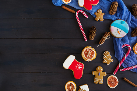 Christmas sweets, ginger cookies on wooden background. Christmas background