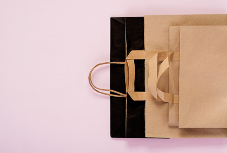 Differents recyclable paper bag on pink background. Eco recycling concept. Top view