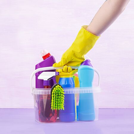 Cleaning service concept. Colorful cleaning set for different surfaces in kitchen, bathroom and other rooms. Stockfoto
