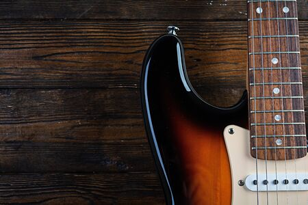 Close-up on electric guitar on vintage old wooden background Zdjęcie Seryjne