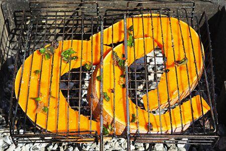 Grilled pumpkin in sugar sauce. Bbq pumpkin 스톡 콘텐츠 - 149024403