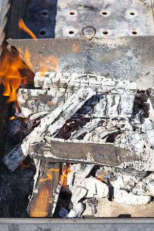 Burning firewood for bbq grill grate 스톡 콘텐츠