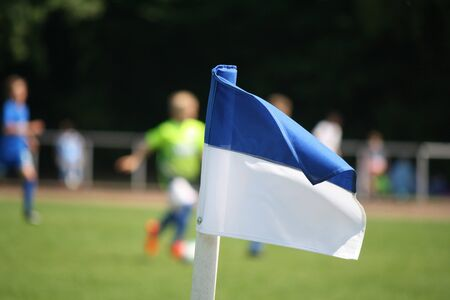 Photo of a Corner flag on a football field Фото со стока