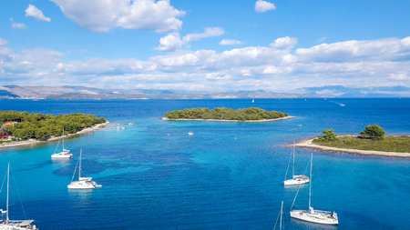 Aerial view of cozy mediterranean island. island paradise. Adriatic Sea of Croatia, popular touristic destination. Clear sea water.