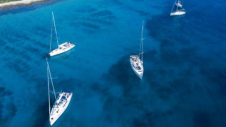 Aerial view of cozy mediterranean island. island paradise. Adriatic Sea of Croatia, popular touristic destination. Clear sea water.