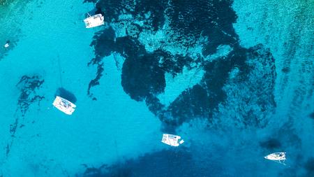 Aerial view of cozy mediterranean island. Blue lagoon, island paradise. Adriatic Sea of Croatia, popular touristic destination. Clear sea water.