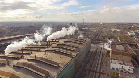 Aerial view of industrial steel plant. Aerial sleel factory. Flying over smoke steel plant pipes. Environmental pollution. Smoke. 스톡 콘텐츠
