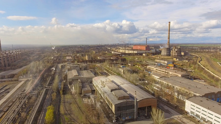Aerial view of industrial steel plant. Aerial sleel factory. Flying over smoke steel plant pipes. Environmental pollution. Smoke. Zdjęcie Seryjne