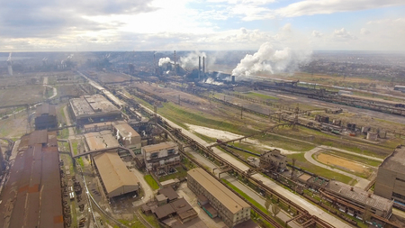 Aerial view of industrial steel plant. Aerial sleel factory. Flying over smoke steel plant pipes. Environmental pollution. Smoke. Stock Photo