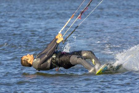 Kiteboarding. Fun in the ocean, Extreme Sport Kitesurfing. Closeup Darkslide. 스톡 콘텐츠