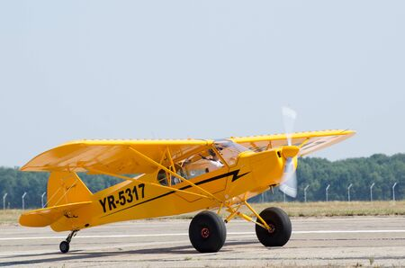 airshow: Puper Cub airplane on airshow Editorial