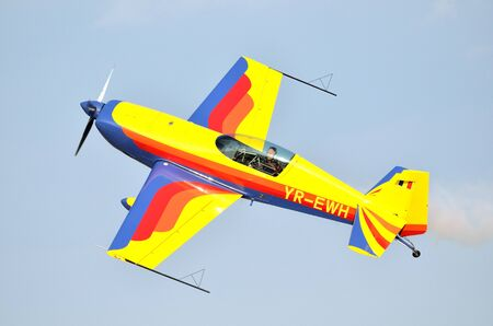 airshow: Extra 300S aerobatics airplane on airshow Editorial