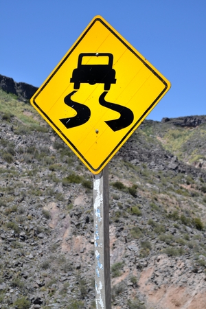 Slippery Road Sign in the Mountains photo