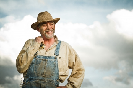 45 55 years: 1930s farmer smiling at the Sun Stock Photo