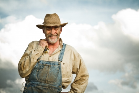60 70: 1930s farmer smiling at the camera
