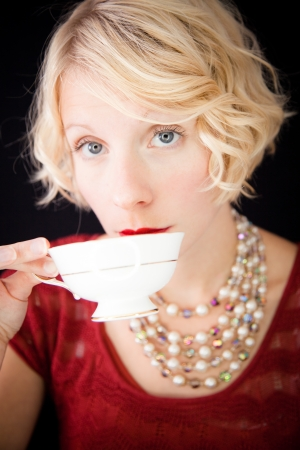 Beautiful Snobbish lady drinking tea photo
