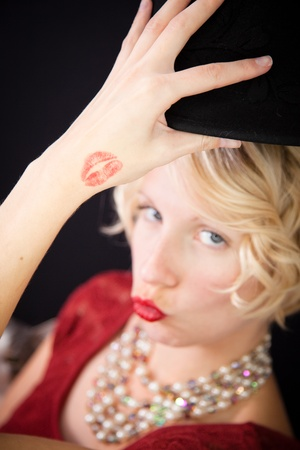 lipstick kiss: Fun lady sending kisses Stock Photo