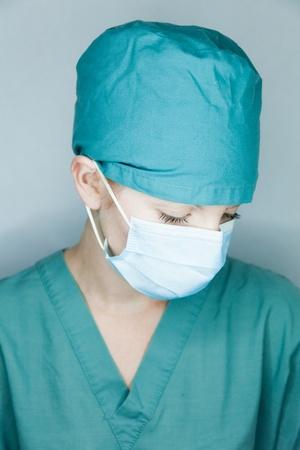 Nurse looking down photo