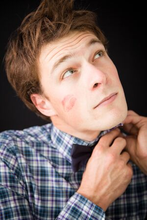 lipstick kiss: Young man with kiss trace on the cheek