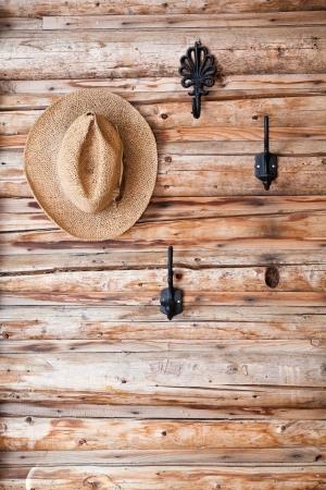 log wall: Hat Hanging on Hook