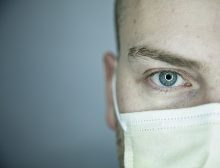 virus protection: Doctor or Patient Eye Looking at You Stock Photo