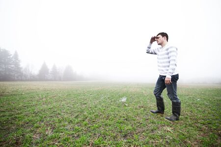 non cultivated: In the foggy field Stock Photo