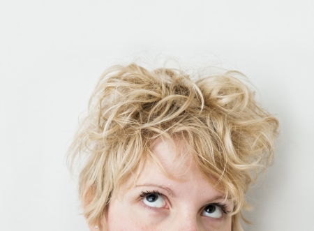 bedhead: Blond Girl Looking Up   Left  mixed hairs  Stock Photo