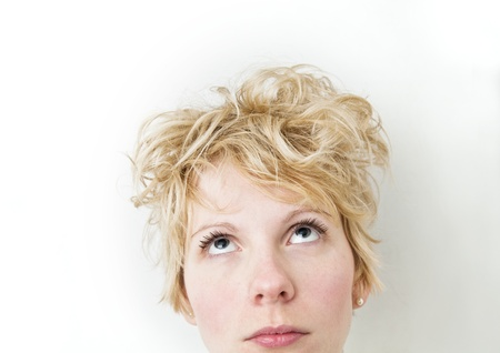 bedhead: Blond Girl Looking Up - VERY Mixed Hairs     Stock Photo