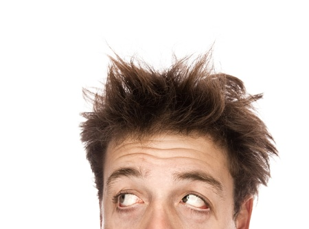 bedhead: Exhausted man looking left - Isolated on white