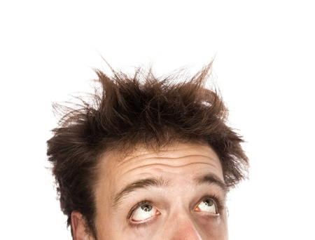 bedhead: Exhausted man looking up - Isolated on white Stock Photo