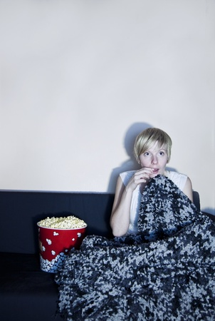 suspense: Girl listen to horror or suspense movie alone  Stock Photo