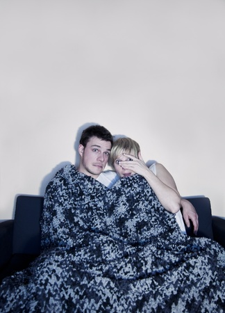 Couple listen to horror or suspense movie  photo