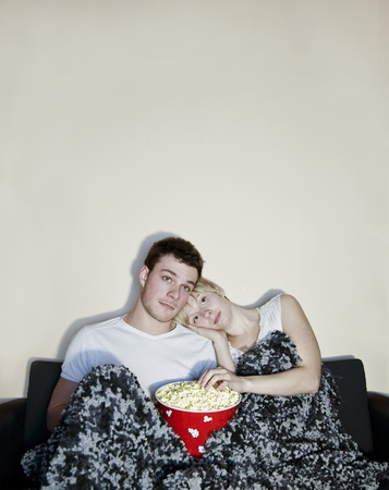 Young couple watching television photo