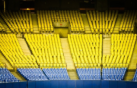 low light: Abandoned Empty Stadium Seats in low light