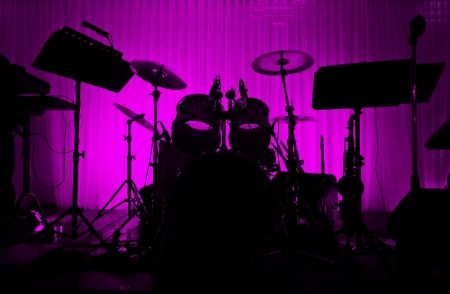 Drum in silhouette with no musician  Empty stage - logo removed Stock Photo