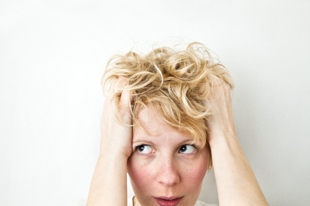messy hairstyle: Blond Girl Pulling Hairs and looking left