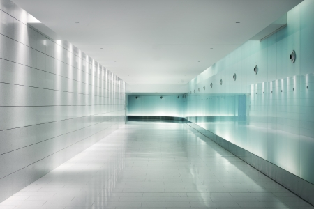 lighting background: Back-lighted glass walls in an underground futuristic corridor