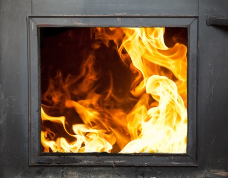 conflagration: Big flames in the fireplace - incinerator