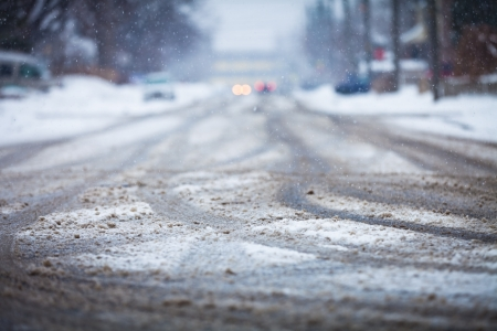 wintry weather: Snow-covered road, the marks of wheels