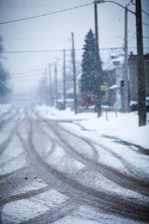 icy conditions: Snow-covered road, the marks of wheels