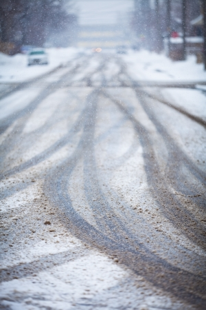 wintry: Snow-covered road, the marks of wheels