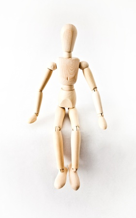 Small Wooden mannequin on a white background Imagens